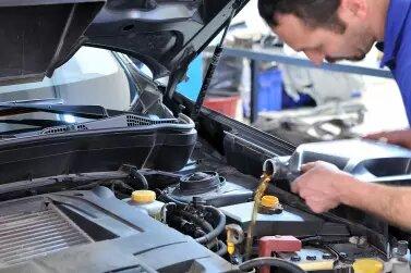 Bigstock Car Mechanic Changing Oil Mo 19473560